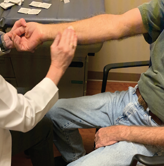 <p>Figure 2. Typically the test is applied to the patient's forearm and bicep. Prepare the patient's skin by cleaning with alcohol pads and allowing the surface to dry.</p>
